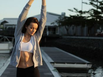 Woman stretching after morning fitness